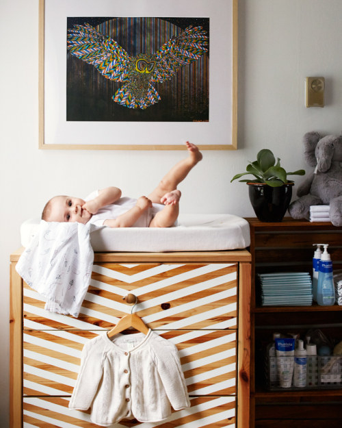 21 Use masking tape and white paint to make an old Ikea dresser seriously stylish via simphome