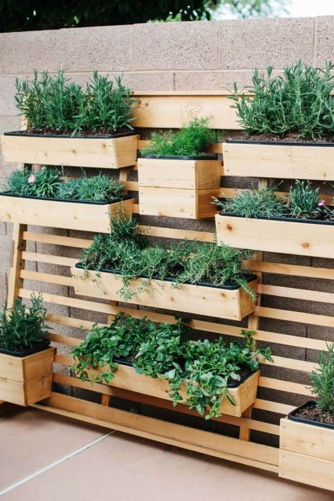 9. Vertical garden with Shelves via SIMPHOME.COM