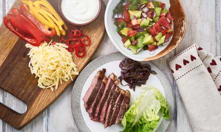 Beef fajitas with avocado salsa, cheese and soured cream