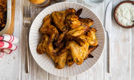 Hot chicken wings in blue cheese sauce