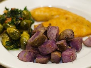Oven Roasted Purple Potatoes on a Plate