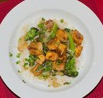Crispy Lemon Tofu with Broccoli Recipe Click to Print Crispy Lemon Tofu with Broccoli Published by Tony Bailey on March 11, 2013 Sweet, Tangy and Delicious  Prep time: 20 minutesCook time: 20 minutes Total time: 40 minutes Yield: 4 servings Ingredients 1 Tablespoon Corn Starch 1/2 Cup Lemon Juice 1 Cup Flavorful Stock 2 Teaspoons Garlic 2 Teaspoons Ginger 1 Tablespoon Brown Sugar 1 Tablespoon Honey 1 Teaspoon Soy Sauce 1/2 White Onion 2 Cups Steamed Broccoli 1 Block Crispy Tofu  Instructions Warm the stock and dissolve the corn starch to make the slurry Mix in the lemon juice, 1 teaspoon of the ginger, 1 teaspoon of the garlic, brown sugar, honey and soy sauce In a wok, or large pan, saute the onions in a small amount of oil for about 5 minutes Add the steamed broccoli, remaining garlic & ginger and saute for another 3-5 minutes Add the lemon sauce, bring to a boil and then reduce the heat to begin reducing it. As it reduces, it will begin to thicken The sauce will take about 10 minutes to thicken, depending on how quickly you boil it Just before you pull the dish to plate it, add the tofu to coat it with the sauce. Serve over sticky rice (short grain white or brown rice)