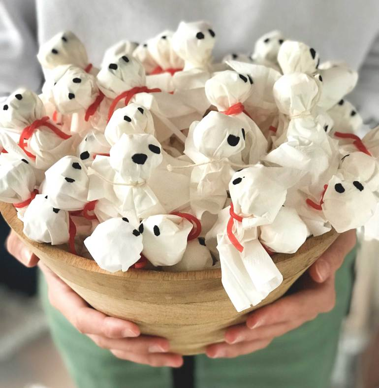 A bowl of ghost lollypops