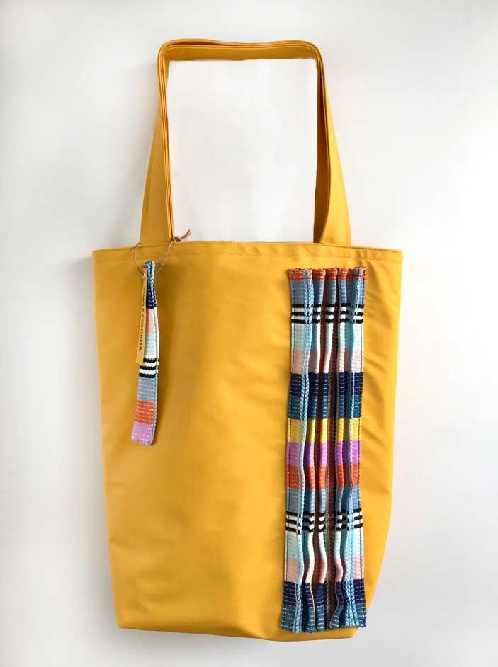 Regenjas geel tas