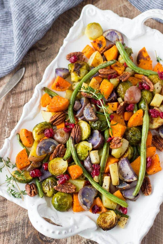 Super Easy Roasted Winter Vegetables- Fancy enough to serve as part of your Holiday meals. Easy enough to make any day! #sheetpan # thanksgiving #cleaneating