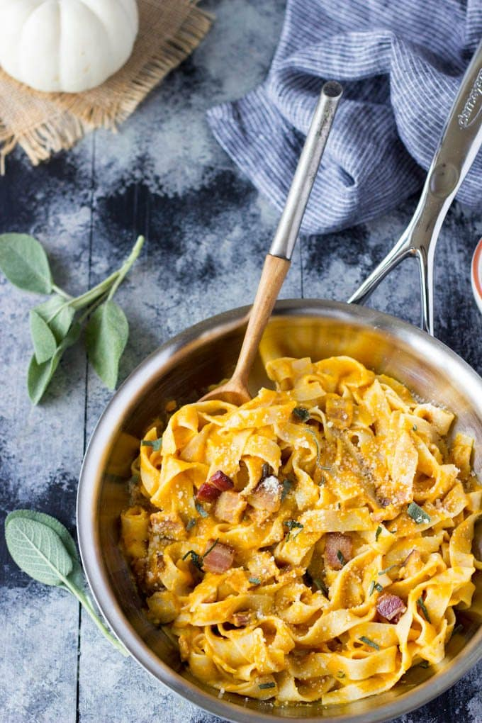So easy! Only a few simple ingredients needed to make this healthy Fall inspired meal. Creamy pumpkin sauce tossed with fettuccine, Parmesan, bacon & sage| simplehealthykitchen.com #easy # pumpkin #fettuccine
