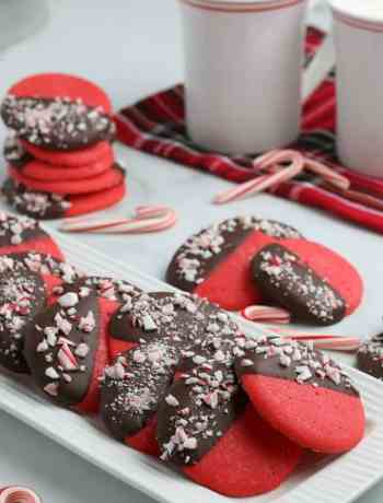 SIMPLE peppermint cookies - deep red and dipped in melted chocolate then sprinkled with crushed candy canes