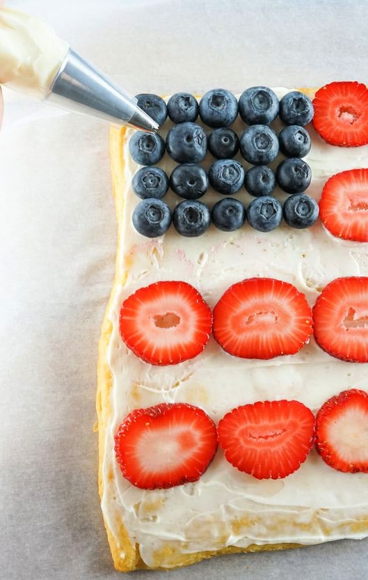 4th of July Fruit Pizza on PIllsburty crescent rolls with blueberries and strawberries