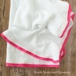 DIY Pom Pom Swaddle Blanket Tutorial