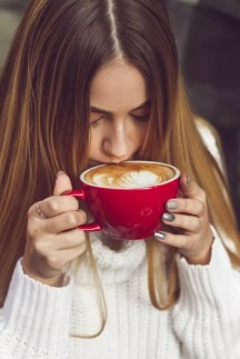 Women drinking a coffee, not knowing how much coffee is too much