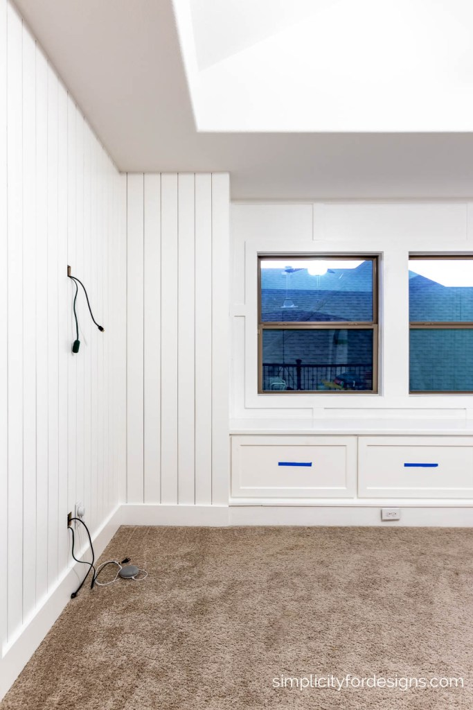 vertical shiplap walls with board and batten framed windows and bench storage