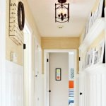 featured photo board and batten hallway with gallery shelves