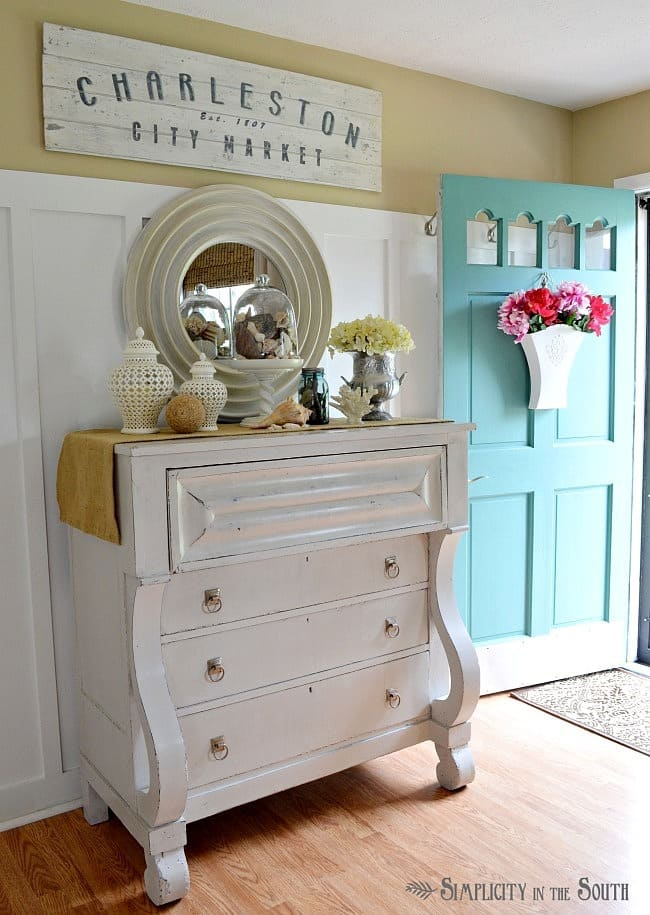White empire chest and turquoise front door