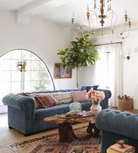 living room blue couches pink pillows wooden table