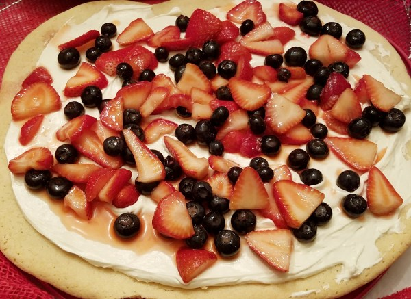 ChaCha's Very Berry Cookie-zza (cookie pizza) Sugar cookie pizza, whipped cream cheese topping and your favorite berries! Strawberry ,blueberry, raspberry, blackberry, razzleberry etc!