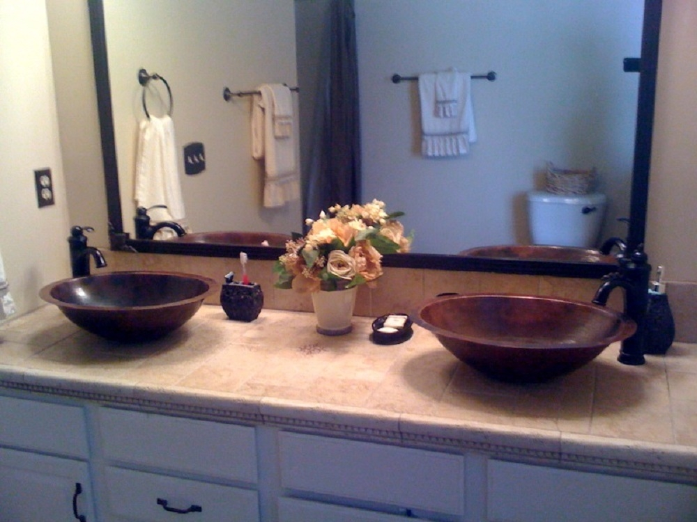 19 oval copper bath sink installed as a vessel