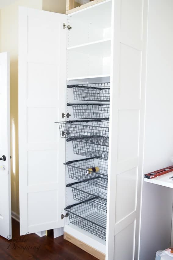 Storage bins in cabinets