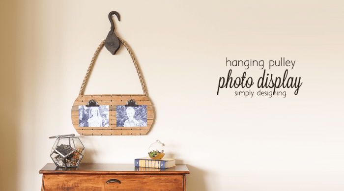 hanging pulley photo display - this fun pallet board makes a great way to display photos and I love this vintage pulley