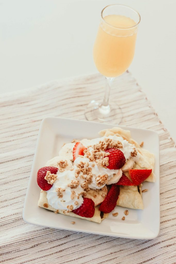 a mimosa for an adult strawberry banana hazelnut crepe meal