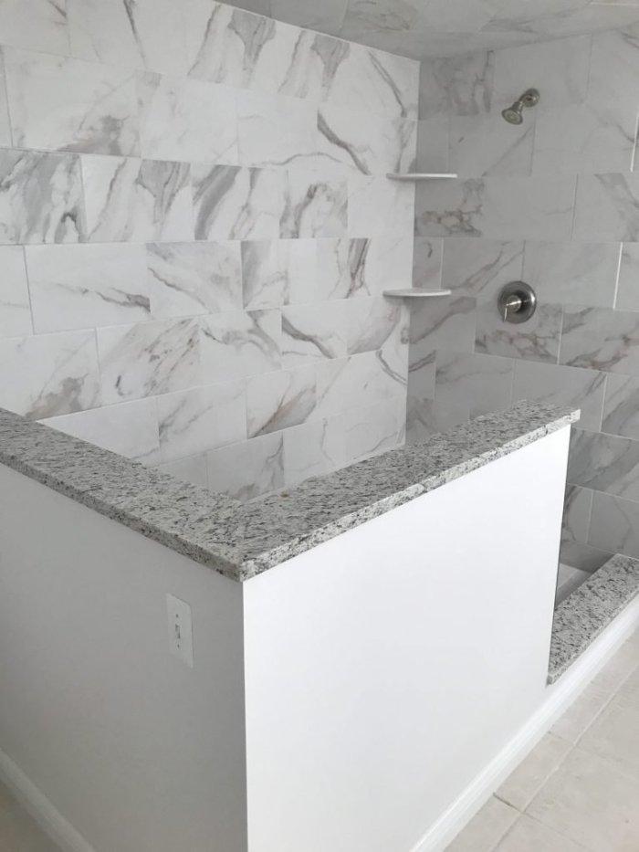 Shower Wall Tile - Calcatta 12x24 // Shower Floor Tile Light Travertine 4x4