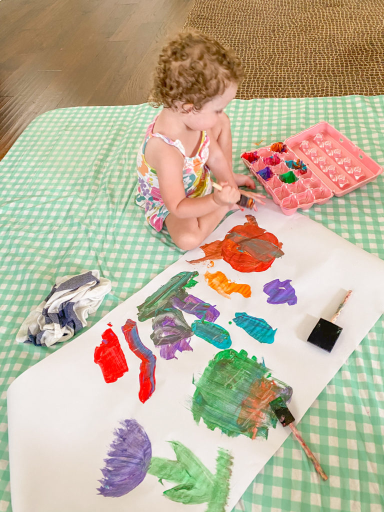 toddler painting and learning colors