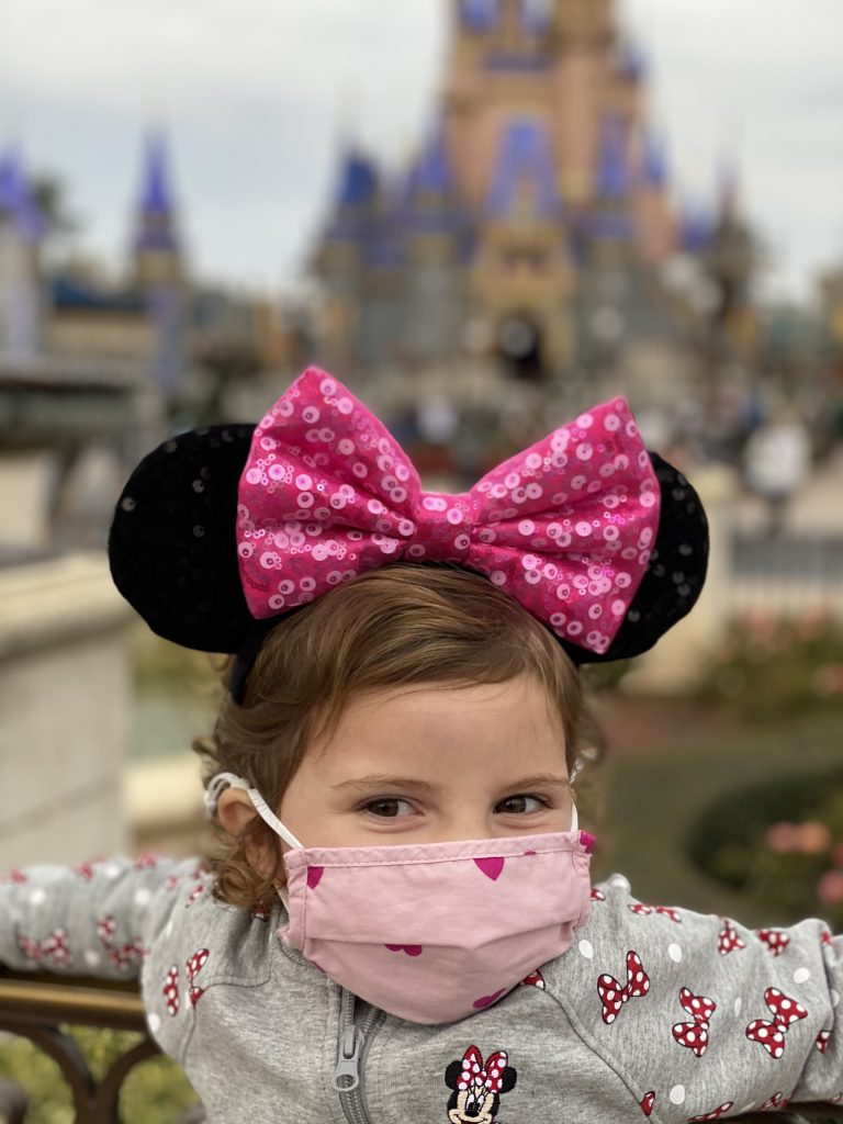 Caroline at Disney World in front of the castle