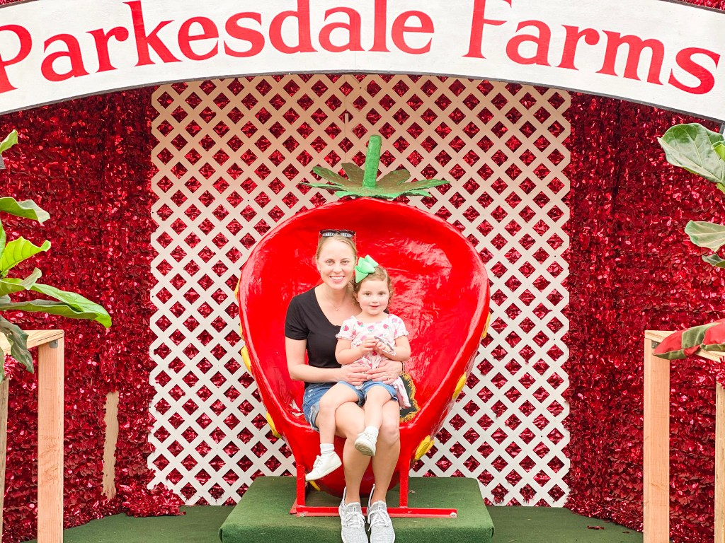 Holley and Caroline sitting on the Strawberry throne at  Parkesdale Market