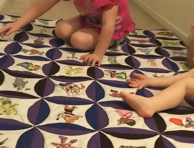 Toddler finding all the characters she recognizes as baby spreads out and rolls around.