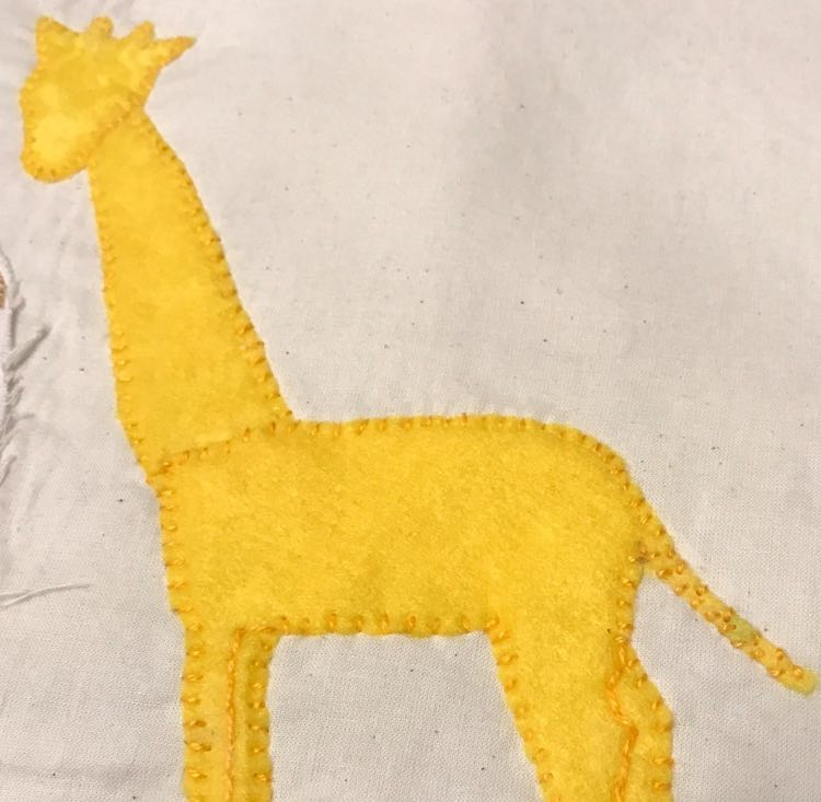 Giraffe sewn to the page.