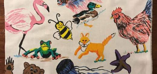 I used my fabric markers to draw animals on a swatch of muslin fabric a bit bigger than 9 by 12 inches and then used an iron to set the ink.