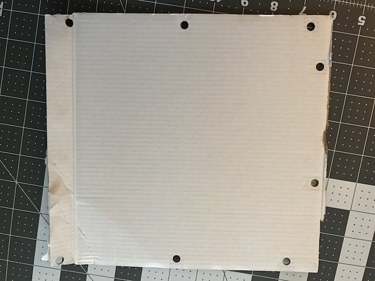 Use a three hole punch to create a template for the grommets.