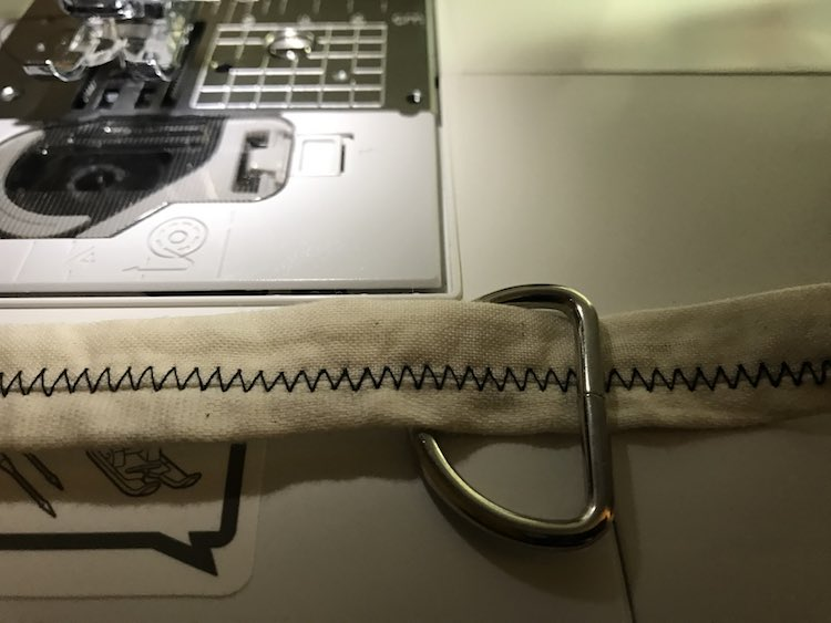 To attach the leash to the collar I started by putting a D ring on the collar.