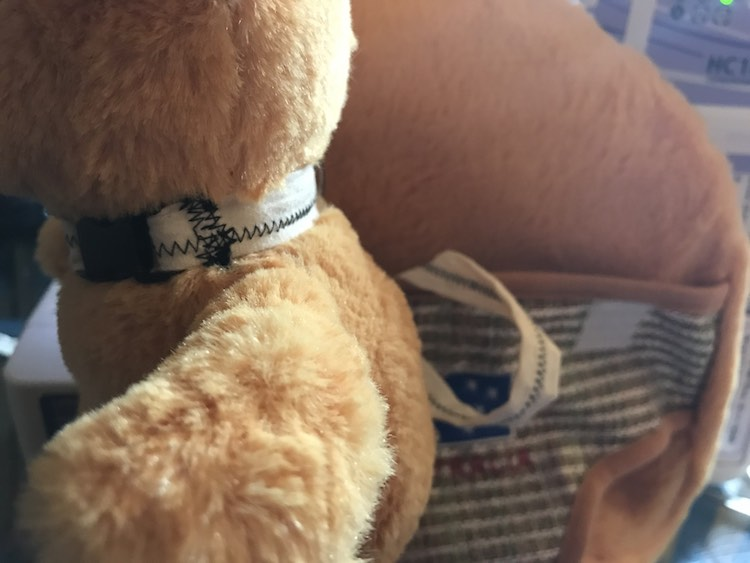 Now attach your stuffed animal to the collar.