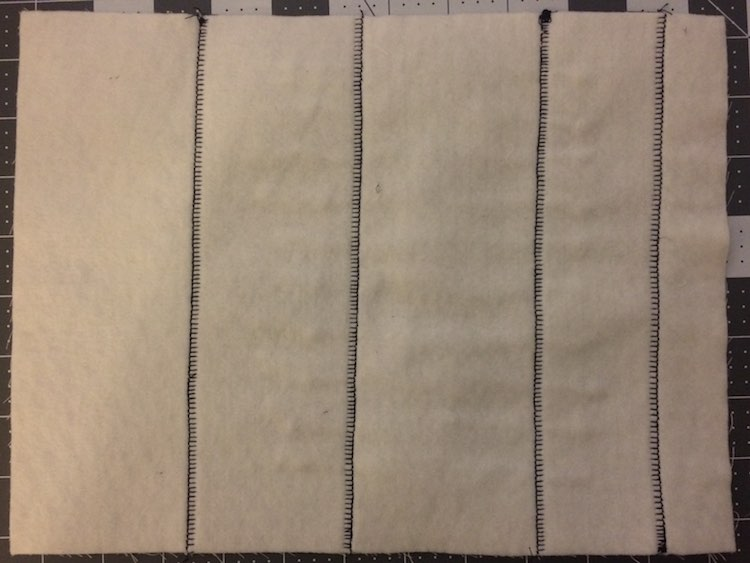 The back of the page just shows the vertical lines where I sewed the purple fabric down. I ignored the top and bottom as it will be sewn together with the reverse side of the page.