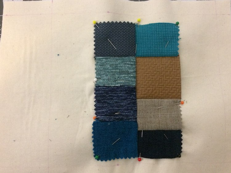 Grid of fabric samples pinned to the page.