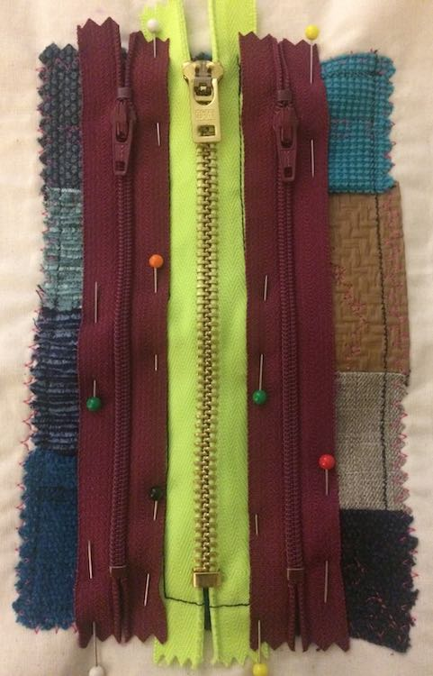 Then pin and sew on the next two zippers on either side of the center.