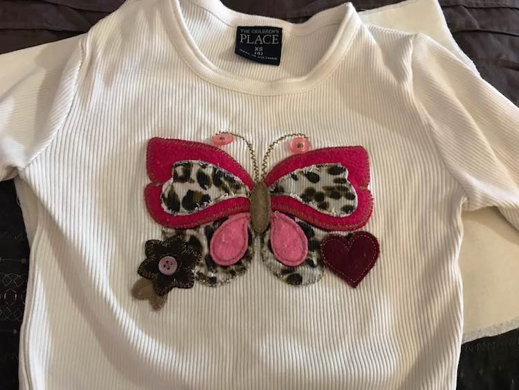 I started with an old shirt I had that Zoey didn't really wear but had a really cool embroidered butterfly on it.