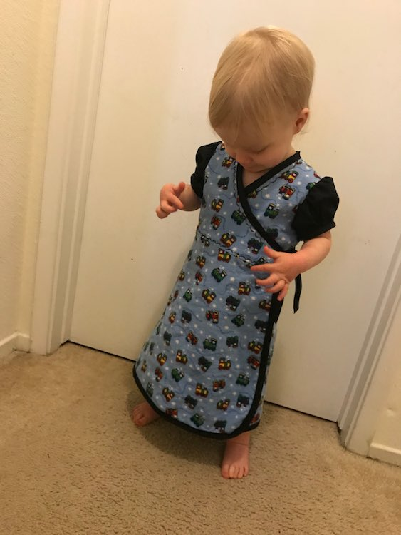 And she's pleased with her new dress.