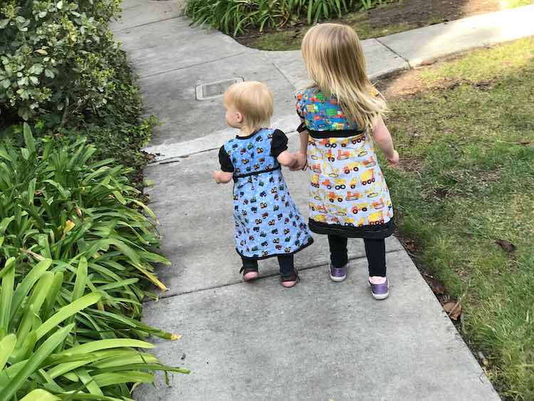 Holding hands while going for their walk.