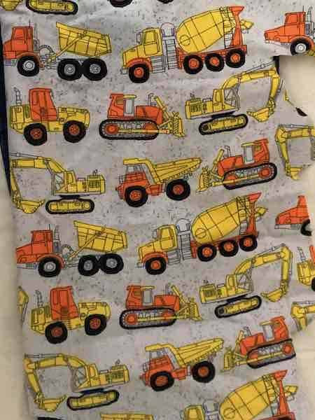 I grabbed our cotton woven construction vehicle fabric and confirmed it was long enough to to stretch the width of the pant legs.