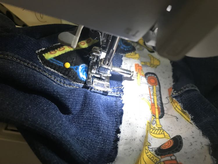 I used a blanket stitch to attach the patches onto the jeans.