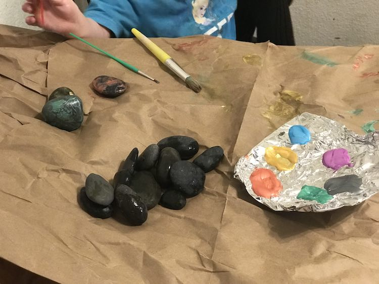 Set out paint brushes, rocks, and paint. We also pull out water to rinse the brushes and paper towel to dry them.