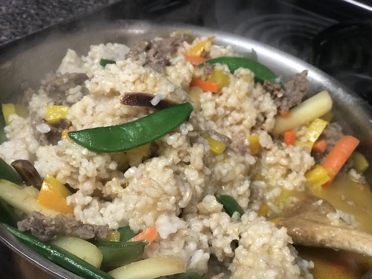 Once the vegetables are cooked add your rice. Break it up and cook until heated through.