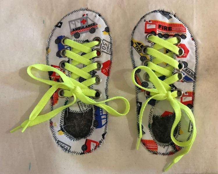 Thread the laces through the grommets and tie up those shoes!