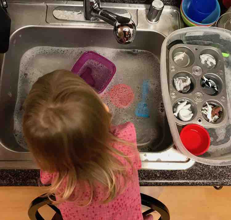 The dirty toys were left in the bin beside the sink and I later added a black colander that fit over the left side of the sink for her to put the 'done' toys.
