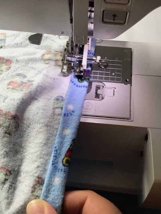 Then sew over the edge keeping the fold in place as you go and leaving a tunnel for the elastic.