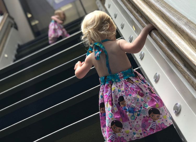 Heading up the stairs in their new dresses.