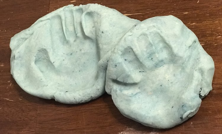 Zoey also wanted to touch the new and warm playdough so we made quick handprints before combining it and setting it aside.