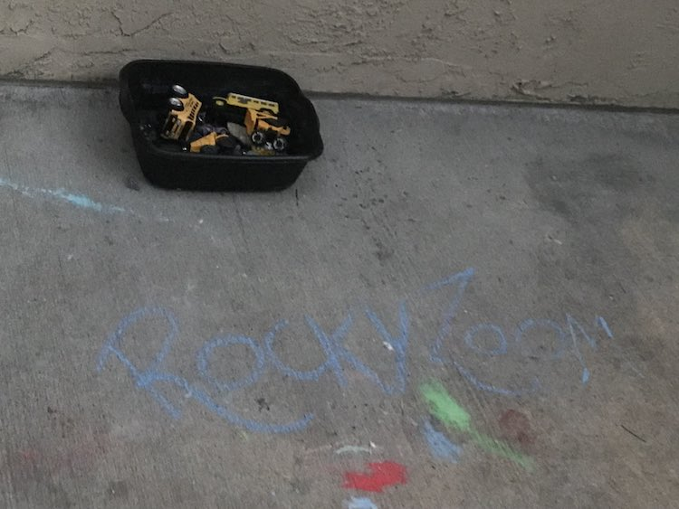 Set the rocks and vehicles out the night before and labelled the space with sidewalk chalk. I kept the rocks in their packaging so they wouldn't mix together.