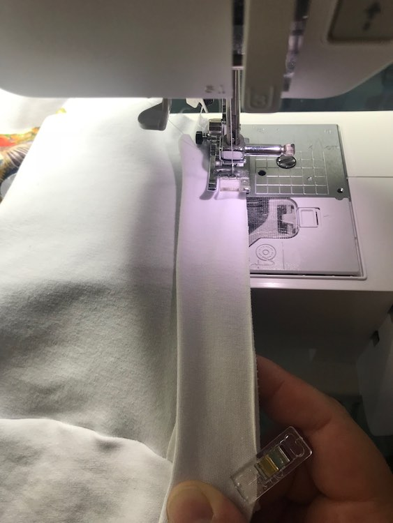 Then while you're sewing you can hold it taunt at the next clip so the layers are lined up and the band is stretched. If the clips or pins are further apart you can stretch it at the clip and then grab a section closer to the sewing machine to keep taunt.